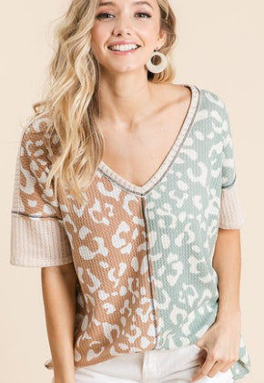 POINTELLE KNIT V NECK TOP WITH PRINT BLOCK FRONT AND CONTRAST STITCHING DETAIL