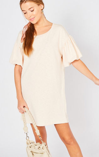 Shift dress featuring puff sleeves. Unlined. Non-sheer. Knit. Lightweight
