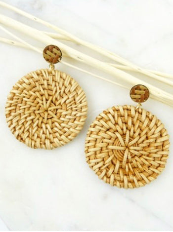 A pair of woven straw disc earrings