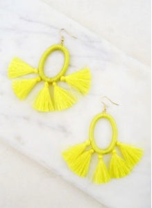 Threaded yellow hoops featuring multiple tassels
