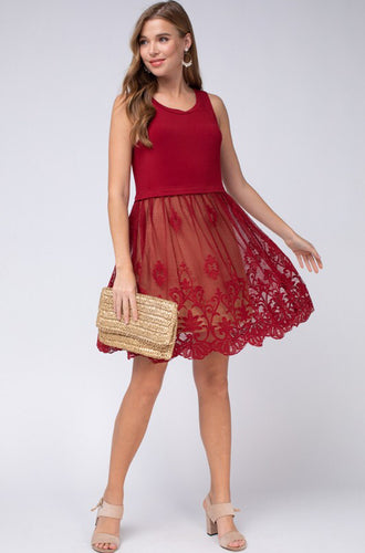 Sleeveless round neck dress featuring lace skirt detail at thigh.