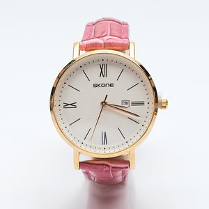 Gold Watch with Pink Leatherette Strap