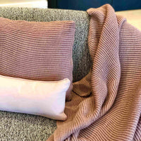 Mauve Pink knitted throw and cushion made from recycled plastic bottles and rectangular soft pink cushion made from recycle cotton clothing.