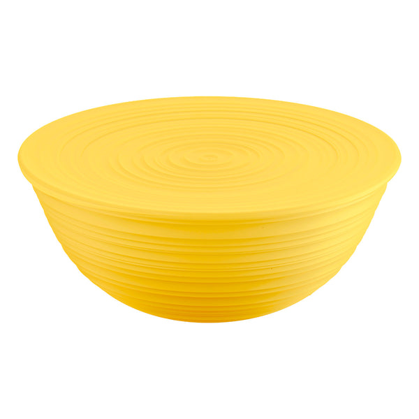 Large yellow salad bowl with yellow lid, by Guzzini. It has a ribbed, organic texture, inspired by nature.