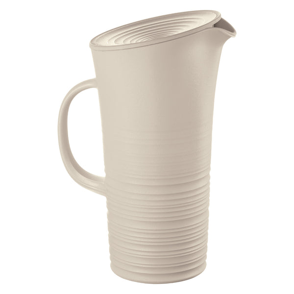 Water or cocktail pitcher and lid made from recycled plastic bottles.  The lower half of the jug has a ribbed, pottery wheel style finish in off-white.