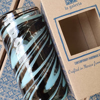 Turquoise & Brown recycled glass cylindrical column vase.  Beside a cardboard gift box.
