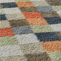 Close up showing multicoloured check recycled cotton mat.