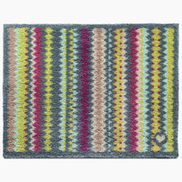 Recycled cotton environmentally friendly doormat with zig zag stripes. Multi coloured, including, grey, purple and lime green.  Non-slip rubber back, sustainably made in the UK.
