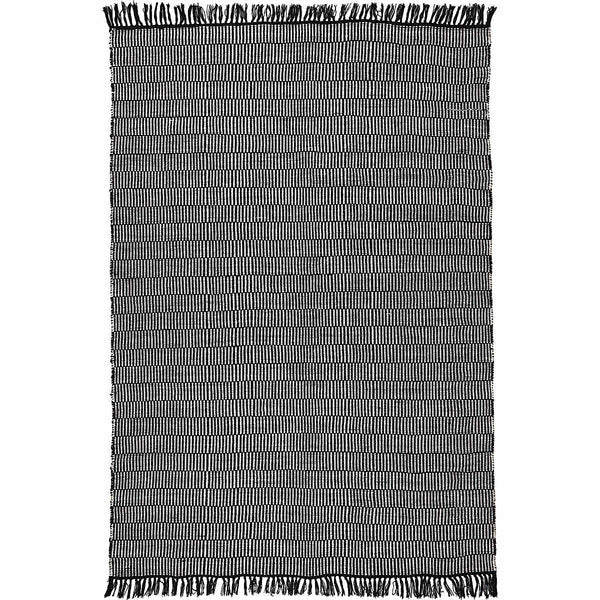 Birds eye view of a rug with rows of small black and white strips. Black fringe at both ends. Made from environmentally friendly recycled plastic (PET) bottles.