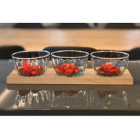 LSA International recycled glass Mia 3 dip tapas bowls on an FSC certified oak board.  Each bowl contains half a dozen wrapped red chocolates.