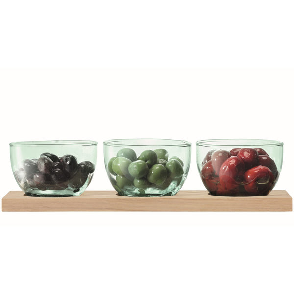 LSA International recycled glass Mia 3 dip tapas bowls on an FSC certified oak board.  Each bowl contains a selection of olives.