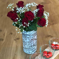 La Galeria Perla recycled glass vase, with contemporary white flaked finish and metallic effect dripping. The vase contains red roses and white flowers, suitable for Valentines day. A great eco-friendly home decor gift.
