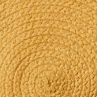 Close up of round recycled yellow cotton rug.