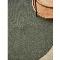 Environmentally friendly round green rug ethically made from recycled cotton.