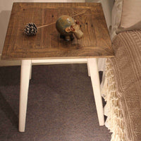 Contemporary recycled furniture. ReChic side table with white pine wood legs and the top made from reclaimed pallet wood.