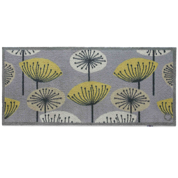 Grey recycled cotton eco rug runner, with graphic flowers on it, that look like dandelions.   Non-slip rubber back.  Made in the UK.