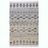 Ivory coloured wool rug, with tribal recycled blue denim pattern. Ethically made and eco-friendly. 120 x 180cm