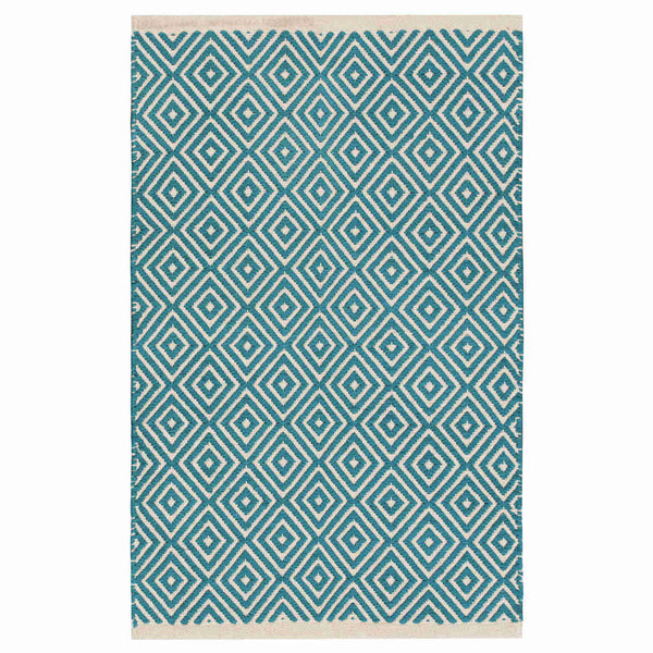 Birdseye view of rectangular turquoise blue eco rug with white geometric design.  Ethically made from sustainable recycled cotton.