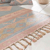 Close up of recycled plastic bottle rectangular rug in pastel shades of pink and blue with symmetrical pattern and centred with a square motif. The ends have plaited tassels. Handmade ethically by traditional Indian artisans.