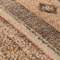 Close up showing detail of sustainable jute rug, with printed design and interwoven recycled sari.