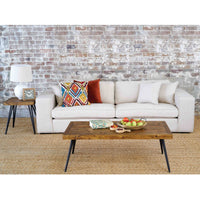 Reclaimed wooden coffee table and side table, situated beside a large white sofa, with brick wall behind.