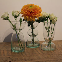 ReChic LSA Eden Project set of three recycled glass, contemporary, small vases.  Containing posy of white roses and a large orange flower