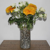 ReChic contemporary, Brown-Grey marble effect recycled glass contemporary, cylindrical vase, containing orange and white flowers.