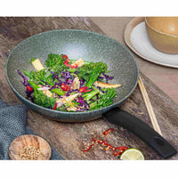Prestige Eco stir-fry pan. Made from recycled aluminium, it has a green non-stick covering with white flecks.  Filled with stir-fry ingredients