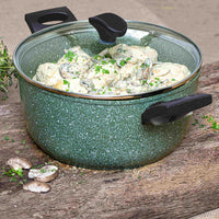 Prestige Eco stockpot. Made from recycled aluminium, it has a green non-stick covering with white flecks. It has a glass lid and black handles. It's filled with a creamy mushroom dish.