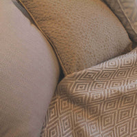 Selection of ReChic taupe-grey coloured throws and cushions made from recycled sustainable cotton and plastic bottles (PET)