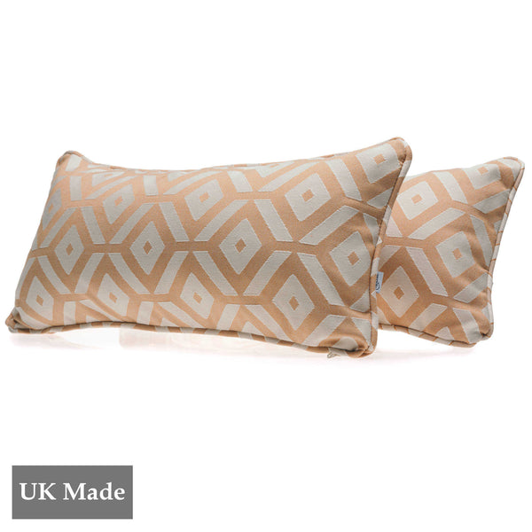 Two rectangular cushions made by ReChic from sustainable, recycled cotton and PET with geometric tessellation of cantaloupe orange and off-white hexagons. 45 x 22.5cm