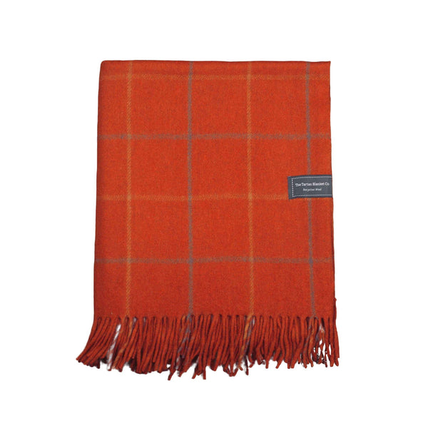 Recycled wool throw or blanket. Rusty red with a light check design.