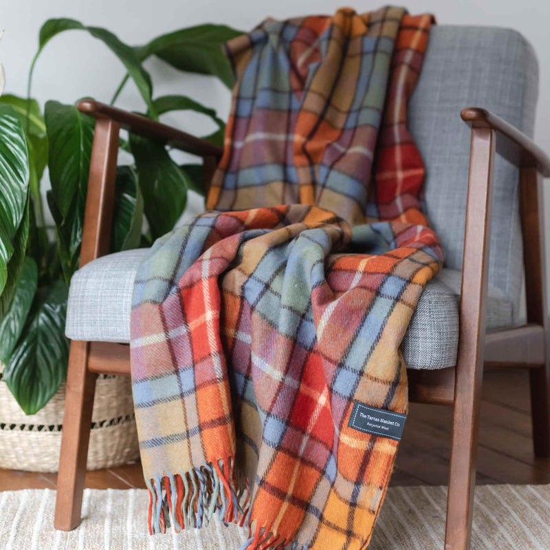 products/ReChic-Tartan-Red-Orange-Recycled-Wool-Throw-Blanket-Sustainable-chair.jpg