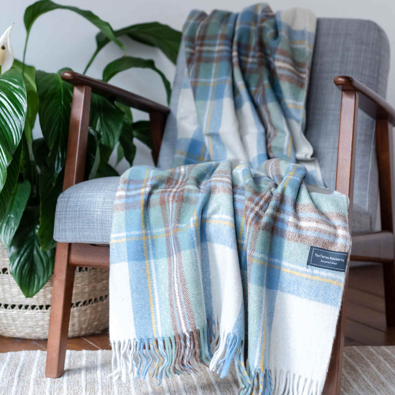 products/ReChic-Tartan-White-Blue-Recycled-Wool-Throw-Blanket-Sustainable-chair.jpg