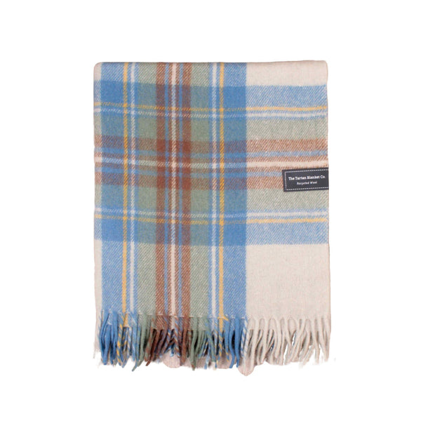 Recycled wool throw or blanket.  White base colour, with pastel blue, green and brown check.