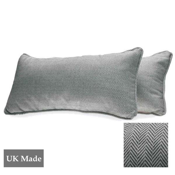 Two rectangular cushions made by ReChic from sustainable, recycled cotton and PET with geometric tessellation of silver-grey and off-white hexagons. 45 x 22.5cm
