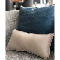 ReChic sustainable UK made recycled cotton cushions, with plastic bottle inner.  A rectangular-oblong taupe/beige cushion with fine chevron design and a square cushion with stonewash navy blue finish.