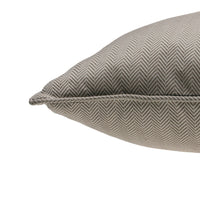 Close up showing piped edge of ReChic recycled cotton and PET cushion with fine chevron design in taupe and off-white.