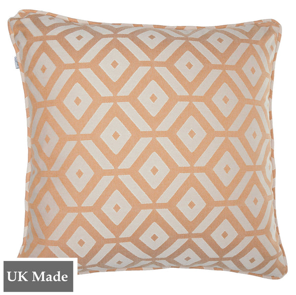ReChic sustainable, recycled cotton and PET cushion with geometric tessellation of cantaloupe orange and off-white hexagons.  45 x 45cm