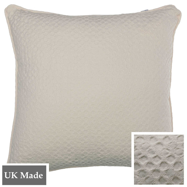 ReChic sustainable, recycled cotton and PET cushion in plain cream colour with textured design like inverted bubble wrap.  45 x 45cm