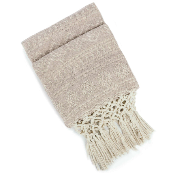 Folded eco-friendly recycled plastic bottle stone grey-taupe throw-blanket with off white geometric pattern and knotted fringe.