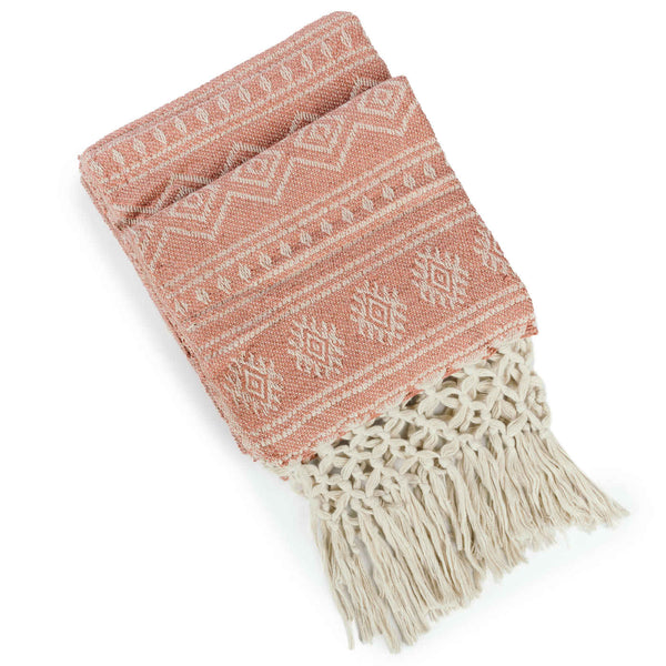 Folded recycled plastic pale red throw-blanket with off white geometric pattern and knotted fringe.