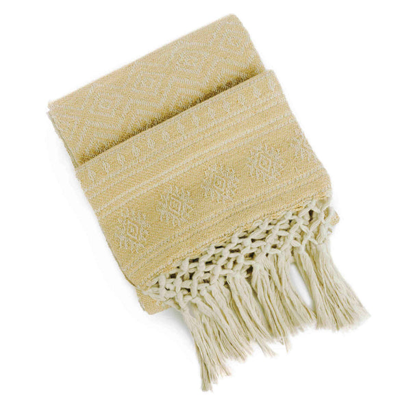 Folded environmentally friendly recycled plastic bottle pale gold-yellow throw-blanket with off white geometric pattern and knotted fringe.