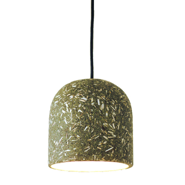 Green lampshade made from recycled Christmas trees and dried reeds.  The organic materials are clearly visible in the design. Sustainable, eco-friendly design.