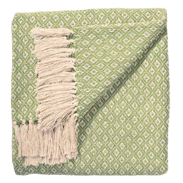 Pale green throw or blanket with white diamond design, made from recycled cotton.