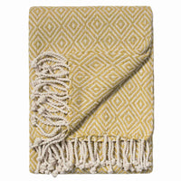 Mustard yellow old gold blanket-throw, ethically made from recycled cotton.  Eco-friendly.