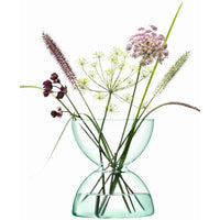 LSA-Eden Project, sustainable, contemporary recycled clear glass diabolo-shaped vase.  Contains half a dozen wildflower stems and grasses.