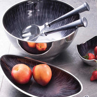 A collection of contemporary, brushed grey environmentally friendly recycled aluminium serveware, some containing fruit.  Displayed are a round salad bowl, oval fruit bowl, small square dipping bowl and set of 3 dipping dishes on a rectangular tray.