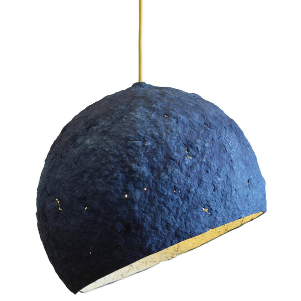 Royal blue eco friendly pendant lamp.  Globe shaped (with the bottom removed) and paper mache (papier-mâché) rough textured finish, showing sporadic holes.  Off-white interior partially visible.