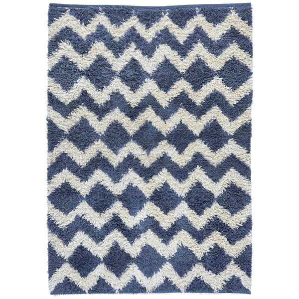 Eco-friendly blue and white zig zig shaggy rug, ethically made from recycled plastic bottles. The large rug shown is rectangular and measures 140 x 200cm